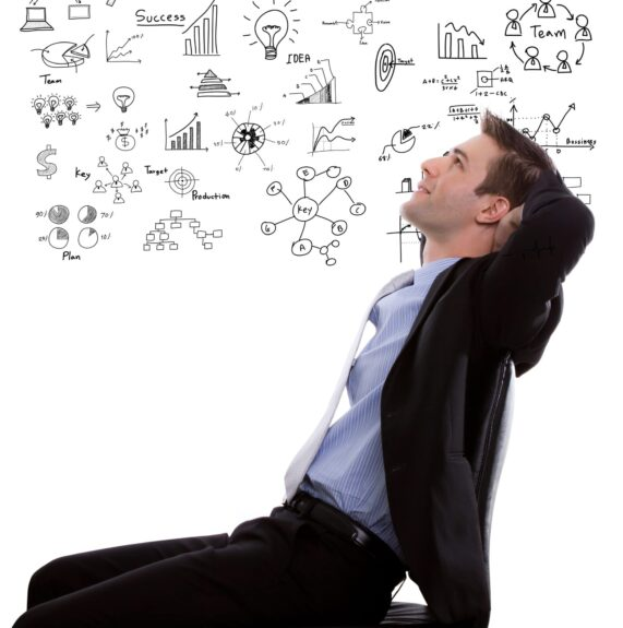 pensive-businessman-with-diagrams-background-min